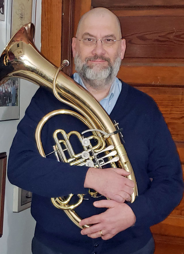 Hornist Tren Cheshier with his Wagner tuba