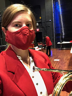 Horn player in Pops concert mask